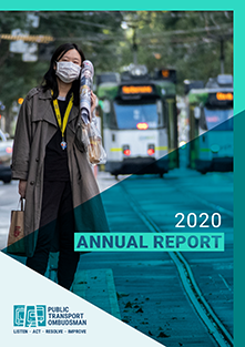 The 2020 Annual Report cover shows a person waiting for a tram while wearing a mask during the COVID19 pandemic. There are two trams in the background.