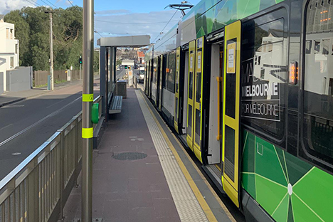 Image shows an empty tram at a deserted tram stop in High Street, Northcote at 3.30pm on Thursday 6 August 2020.